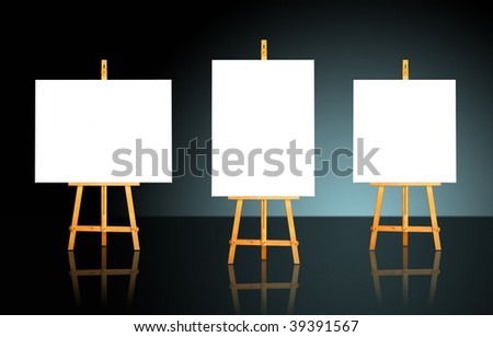 Three blank white canvas on easels over a dark background - stock photo