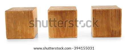 Three blank wooden cubes isolated on white - stock photo