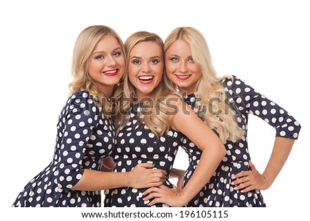 three blonde girl in dot dresses and red lipstick over white background  - stock photo