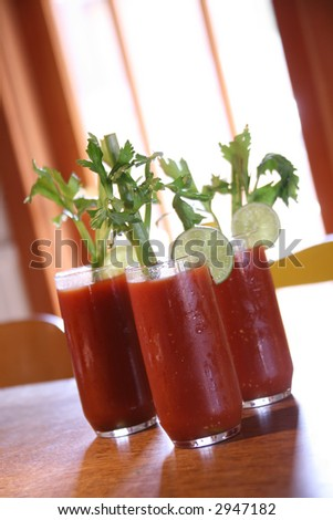 Three Bloody Mary Cocktail Drinks With High Depth of Field - stock photo