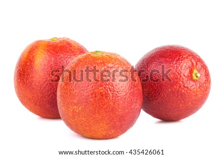 Three bloody red oranges isolated on white background. - stock photo
