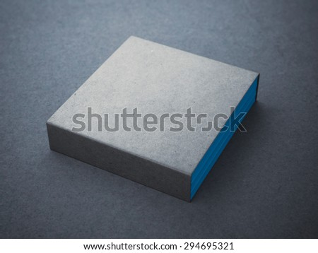 Three blue books with blank box cover - stock photo
