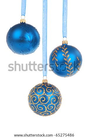 Three blue Christmas baubles hanging isolated on white background - stock photo
