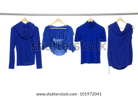 three blue clothes on a hanger - stock photo
