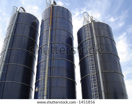 Three Blue Farm Silos - stock photo