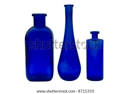 three blue glass vases with white background