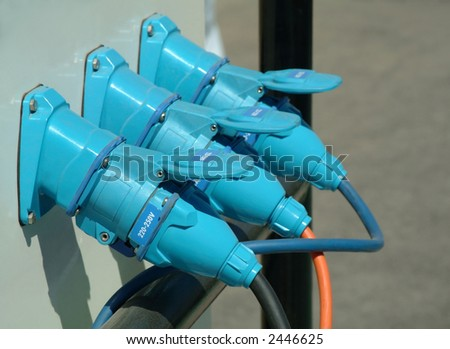 Three  blue power plugs connected in industrial plant - stock photo