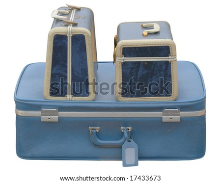 Three blue suitcases on a parking lot