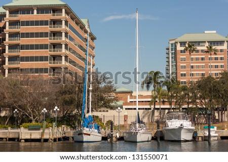 Three Boats Moored Along the Hillsborough River, Tampa, Florida - stock photo