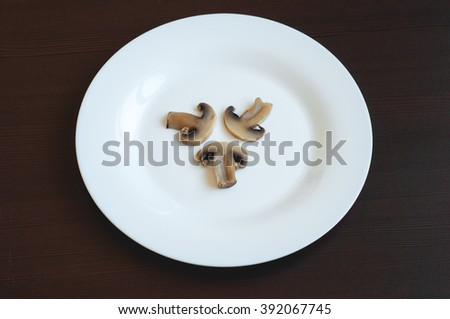 three boiled mushrooms on a large plate - stock photo