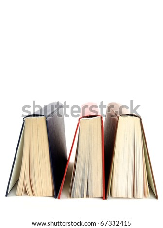 Three books stands a back up on a white background - stock photo