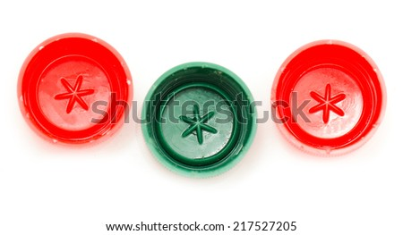 three bottle cap with green and red - stock photo
