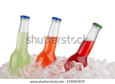 Three bottles in ice isolated on white background  - stock photo