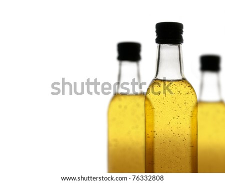 Three bottles of a fizzy drink, isolated on white background, with a shallow depth of field. - stock photo