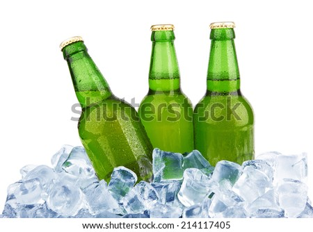 Three bottles of beer on ice isolated on white background