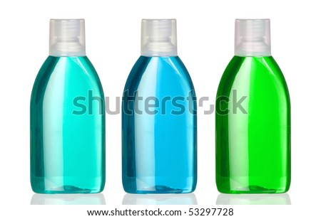Three bottles of mouthwash with reflection on white background - stock photo