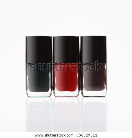 three bottles of nail polish on white background