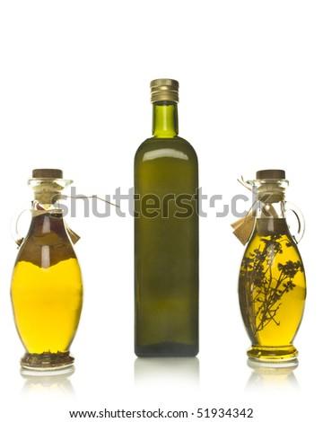 Three bottles of olive oil - stock photo