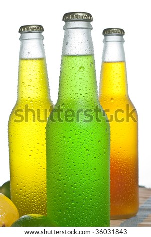 Three bottles with cold drinks - stock photo