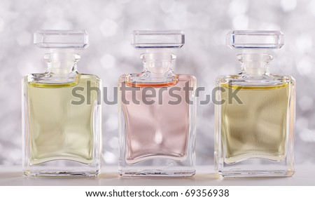 Three Bottles with Perfume - stock photo