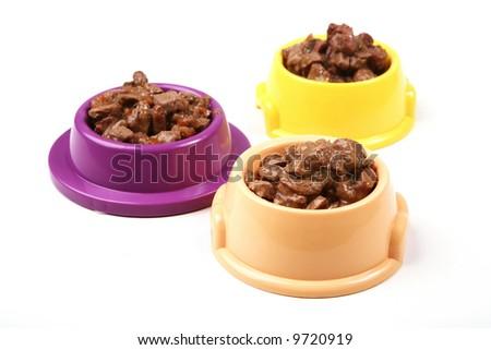 Three bowl of animal food - stock photo