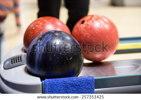three bowling marble ball marble at front