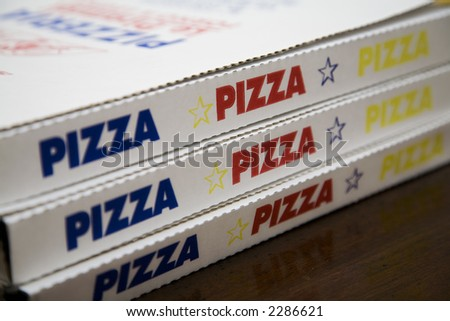 three boxes of pizza for a movie night with friends - stock photo