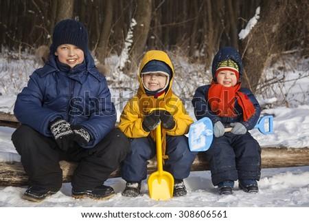 three boy play on snow - stock photo