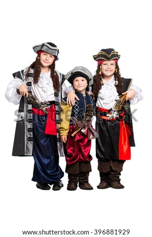 Three boys dressed as pirates. Isolated on white