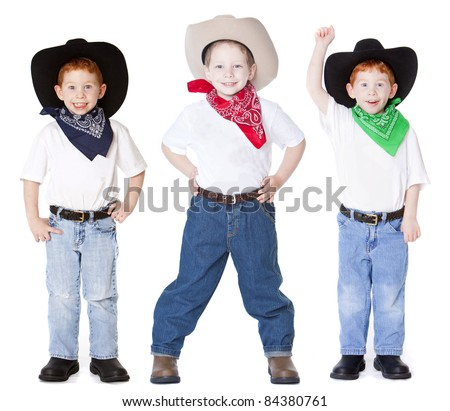 Three boys dressed up as cowboys in studio