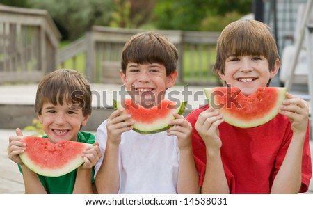 Three Boys Eating Watermelon - stock photo
