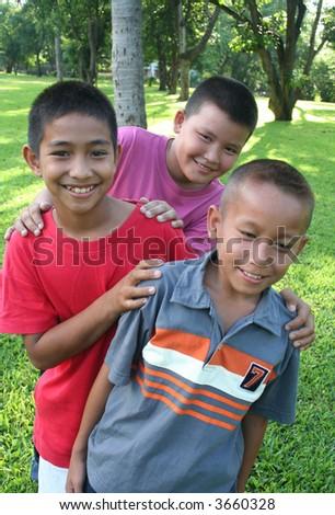 Three boys having good time - stock photo