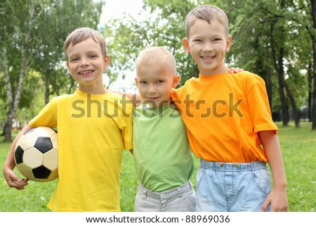 Three boys in the park with a ball