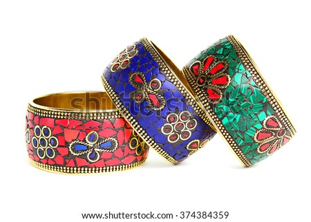 Three bracelets white background. Blue, red and green bracelets in the folk style