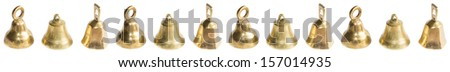 Three brass bells multiplied in a row isolated on white. - stock photo
