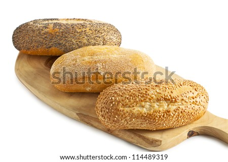 three breads on the wooden plank - stock photo