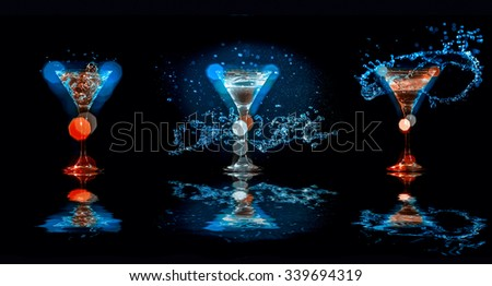Three Bright cocktails in glasses on black background with reflection - stock photo