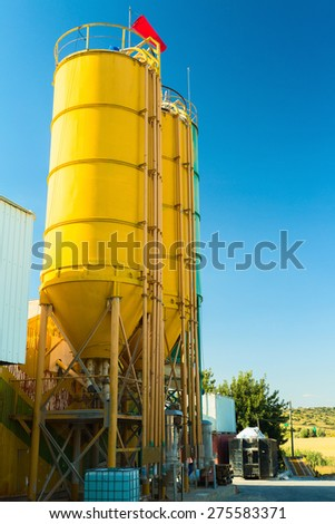 Three bright round metal towers on chemical plant - stock photo
