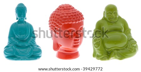 Three brightly colored buddha statues.  Seated buddha in blue.  Buddha head in orange.  Fat buddha in green.  File includes clipping path. - stock photo