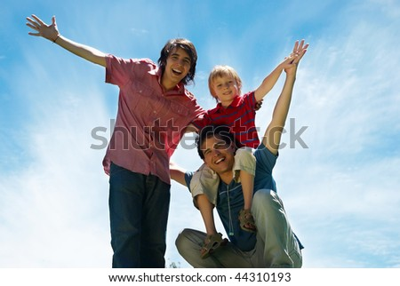 Three brothers of different return against the sky - stock photo