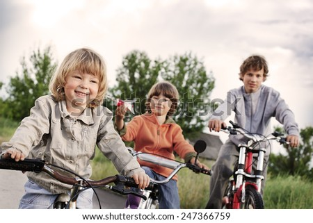 three brothers ride bikes