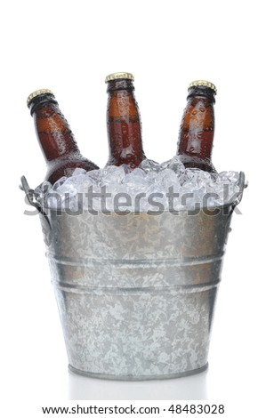 Three Brown Beer Bottles in Ice Bucket with Condensation isolated on white vertical composition with reflection - stock photo