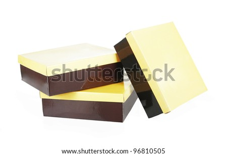 three brown boxes with yellow lids isolated on white - stock photo