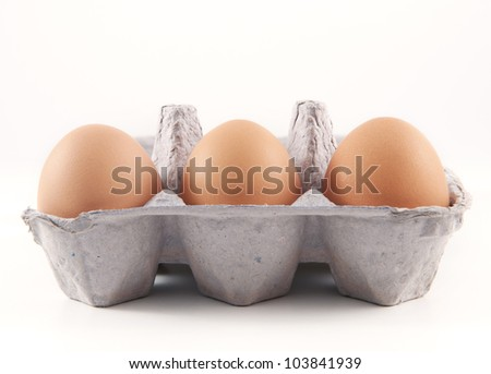 Three Brown Eggs - stock photo