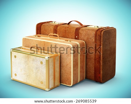 three brown leather suitcase on blue background - stock photo