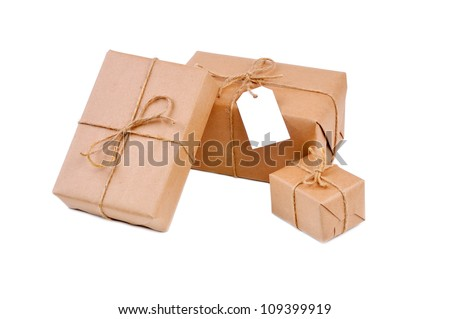 Three brown packages isolated on white - stock photo