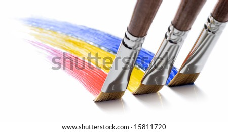 three brushes painting colors - stock photo