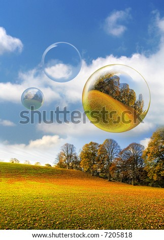Three Bubbles float across a leaf covered Park on a stunning Bright Autumnal Day in Northumberland England - stock photo