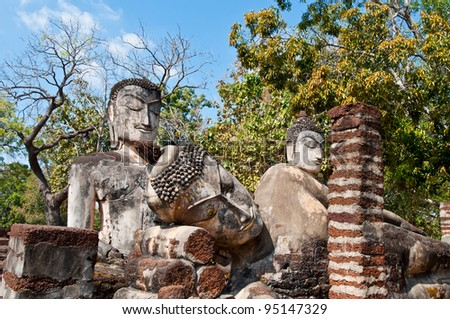 Three buddha statues in historical park, Kamphaengphet province, Thailand.