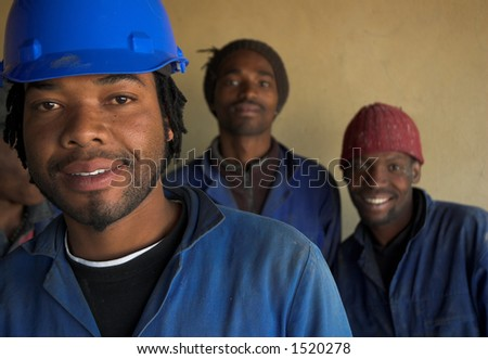 Three building, plumbing construction workers